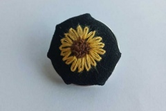 Hand-embroidered-sunflower-brooch.