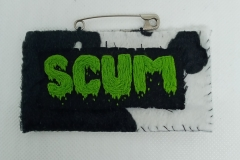 Hand-embroidered-upcycled-SCUM-brooch.