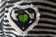 Hand-embroidered-upcycled-slimy-heart-brooch.