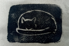 Lino-printed-Cat-naps-patch-black-on-beige-close-up.