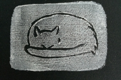 Lino-printed-Cat-naps-patch-white-on-black-close-up