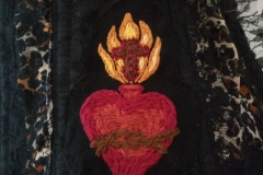 Hand-embroidered-Sacred-heart-patches-on-a-collaboration-piece..
