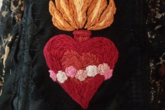 Hand-embroidered-Sacred-heart-patches-on-a-collaboration-piece.