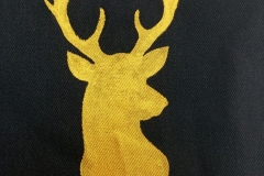 Hand-painted-upcycled-stag-sigil-close-up.
