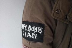 Upcyceld-parka-with-hand-embroidered-and-recycled-patches-band-patch-details