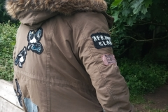Upcycled-Jacket-with-a-few-hand-embroidered-patches.