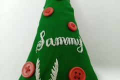 Hand-embroidered-upcycled-Christmas-decoration.-Close-up-of-name