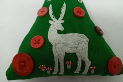 Hand-embroidered-upcycled-Christmas-decoration.-Close-up-of-reindeer