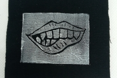 Lino-printed-Monster-moutch-patch-white-on-black.