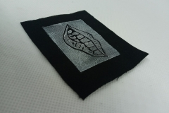 Lino-printed-Monster-mouth-patch.-White-on-black.
