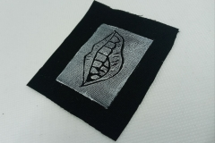 Lino-printed-Monster-mouth-patch.-White-on-black