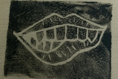 Lino-printed-Monster-moutch-patch-white-on-black-close-up