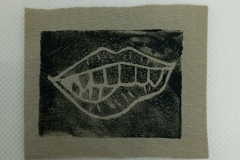 Lino-printed-Monster-mouth-patch-black-on-beige.