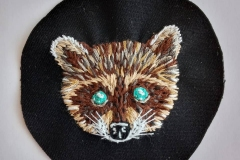 Hand-embroidered-raccoon-with-turquoise-eyes-patch