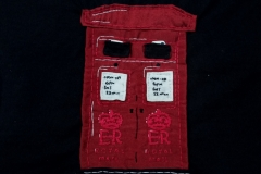 Hand-embroidered-upcycled-post-box-bag-close-up.