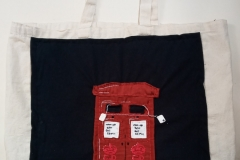 Hand-embroidered-upcycled-post-box-bag.