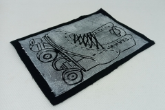 Lino-printed-Get-your-skates-on-patch-white-on-black.
