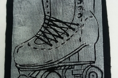 Lino-printed-Get-your-skates-on-patch-white-on-black