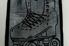 Lino-printed-Get-your-skates-on-patch.-White-on-black.
