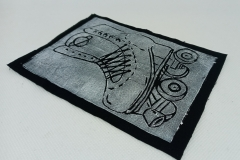Lino-printed-Get-your-skates-on-patch.-White-on-black