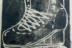 Lino-printed-Get-your-skates-on-patch-black-on-beige-close-up