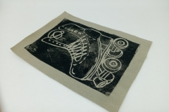 Lino-printed-Get-your-skates-on-patch-black-on-beige