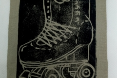 Lino-printed-Get-your-skates-on-patch.-Black-on-beige.