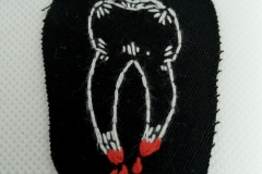 Hand-embroidered-bloody-tooth-patch.